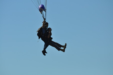 Silhouette of Two Men Skydiving Stock Photo