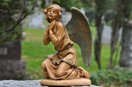 Statue of a Young Female Angel Kneeling and Praying