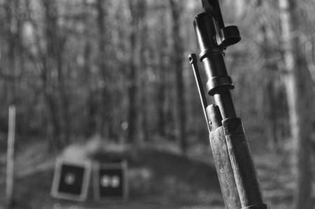 Black and White Image of a Mosin Nagant Gun Rifle at a Shooting Range
