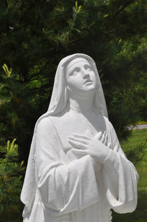 Statue of Mary looking up and praying