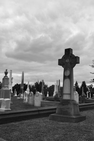 Celtic Cross Statue in an Irish Catholic Cemetery Editorial
