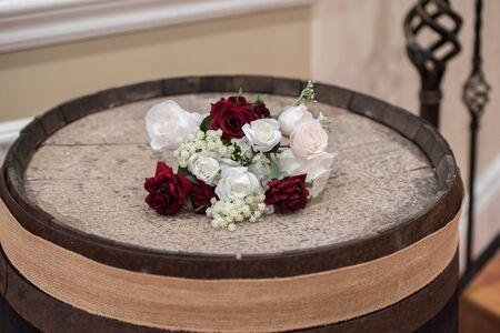 Bridal Bouquet on an Oak Barrel at a Rustic Style Wedding Reception