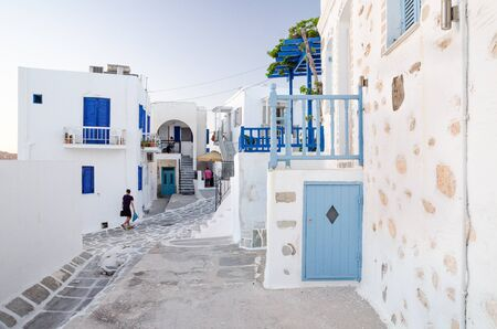 A typical street with white houses in Paros or Parikia, Cyclades islands, Greece Editorial