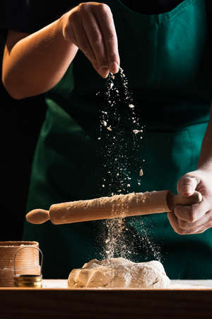 Hands of a chef baker woman kneading dough