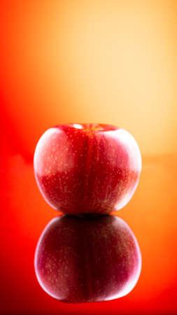 Large fresh red apple on red background gala schnico brookfield mema devil must Archivio Fotografico