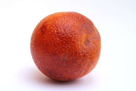 Isolated image of a single blood orange