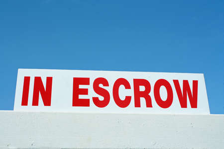 In Escrow sign, used by realtors  Stock Photo