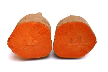Two halves of a cut sweet potato Stock Photo