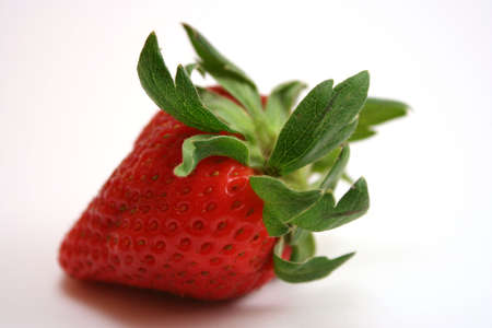 close up on the leaves of a fresh red strawberry
