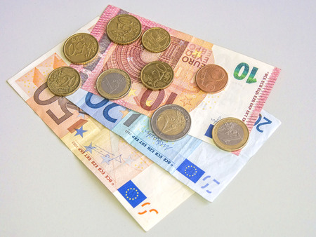 2 50: European currency on a table shot from above