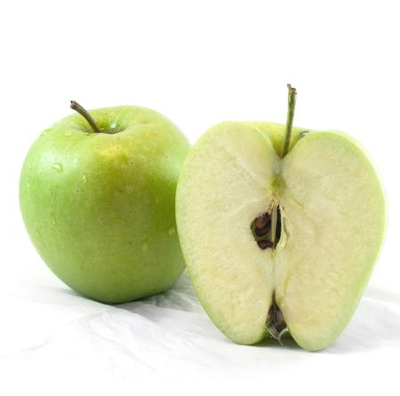 vitamines: Fresh cut green apple on white background