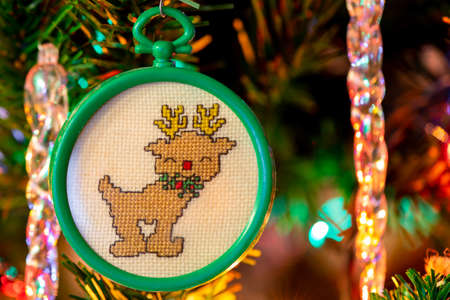 Rudolph the red nosed reindeer handmade cross stitched Christmas tree decoration, ornament. Christmas card.