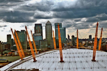 o2: O2 Arena and Canary Wharf mixing with grey clouds  East London  UK