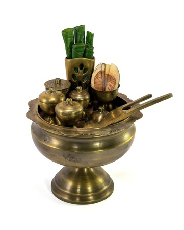 areca: a brass bowl containing betel leaves and areca nuts