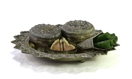 a silverware containing betel leaves and areca nuts photo