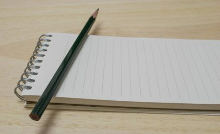 blank notebook with a pencil photo