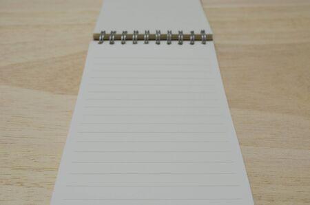 blank notebook on wood board photo