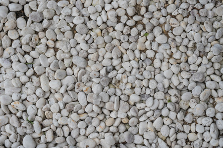 Pebble stone background,abstract dry garden round stones texture background, Material for construction Stock Photo