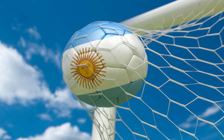 Argentina flag and football in goal net