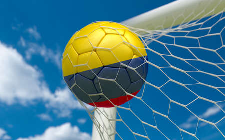 goal flag: Colombia flag and soccer ball, football in goal net Stock Photo