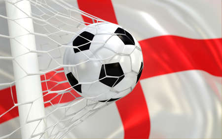 england flag: England flag and football in goal net Stock Photo
