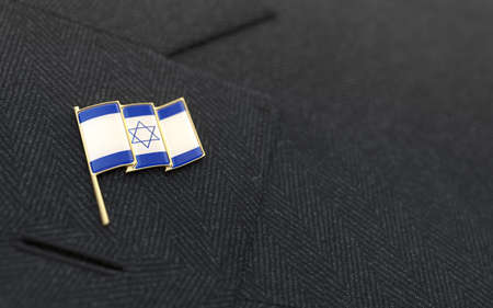 Israel flag lapel pin on the collar of a business suit jacket shows patriotism photo