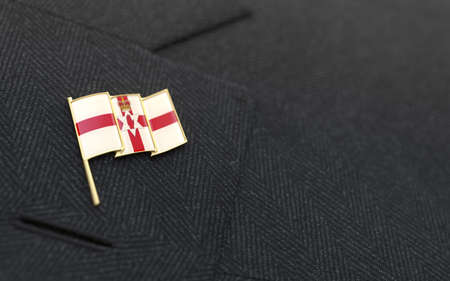 Northern Ireland flag lapel pin on the collar of a business suit jacket shows patriotism photo