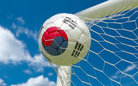 South Korea flag and soccer ball, football in goal net photo