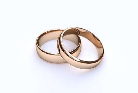 Golden wedding rings on white background, close up Foto de archivo