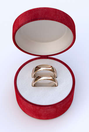 Luxury Couple of gold wedding rings in box on white background photo
