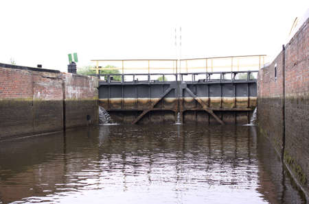 fluvial: Lock gates and channel of sluice, spring Stock Photo