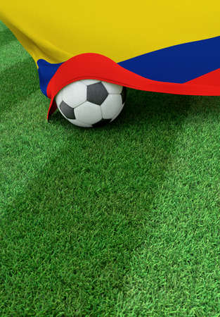 Soccer ball and national flag of Colombia lies on the green grass