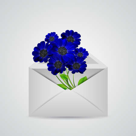 Envelope with a bouquet of blue flowers inside.