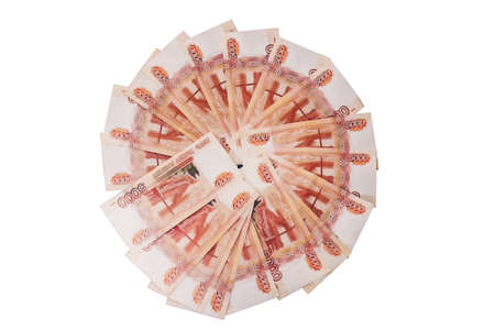 Russian five-thousandth banknotes laid out around isolated on white