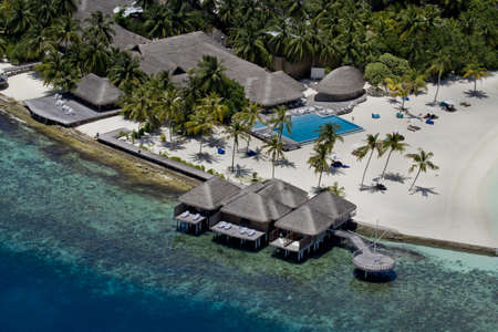 Resort on top coral reef atolls in Maldives photo