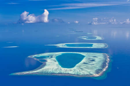 Coral reef atolls in Maldives photo