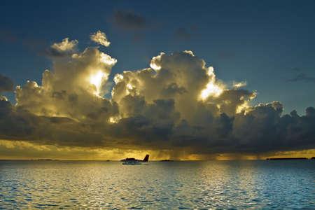 A setting sun and a lone seaplane