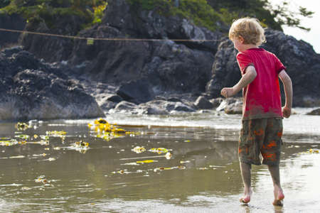 vancouver island: A young boy at the edge of a tidal pool