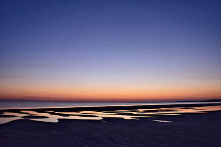 Stunning beach sunrise over tidal pools Reklamní fotografie