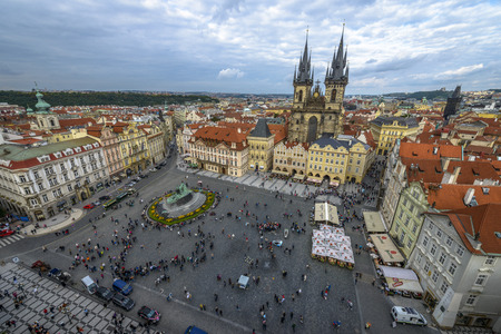 Tourists enjoying Old Town Square, Tyn Church in Prague a crowded cloudy day