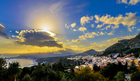 Taormina, Sicily view from the Greek theatre with sunrays over Etna mountain photo