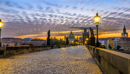 Charles Brdige in Prague at Sunrise with beautiful intense golden hour. photo