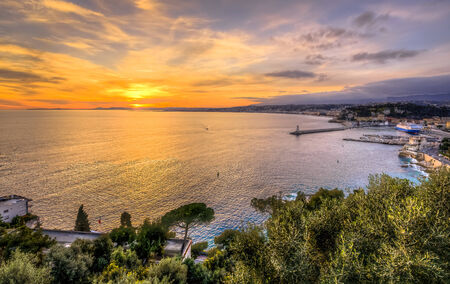 Aerial view of beach in Nice at sunset from Nice Castle photo