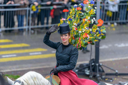 costum: Nice - February 23: Female Entertainer riding a horse in carnival Costum at the Nice Flower Carnival on February 23, 2013 in Nice, France