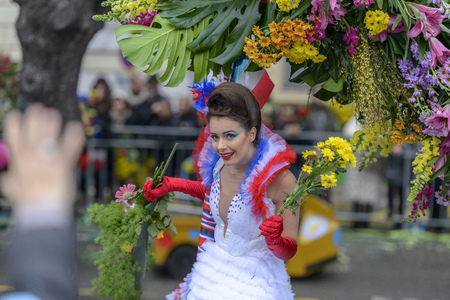 costum: Nice - February 23: Female Entertainer in carnival Costum at the Nice Flower Carnival on February 23, 2013 in Nice, France