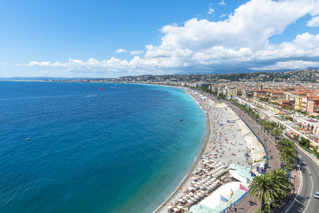 Aerial view of Nice from the Castle in a summer day with swimmers enjoying the weather