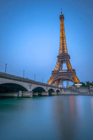 Long night Exposure of Eiffel Tower and Seine River at dusk from Port Debilly in Trocadero photo