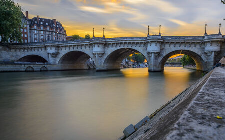 Long Exposure of Pont Neuf at sunset in Paris, France photo