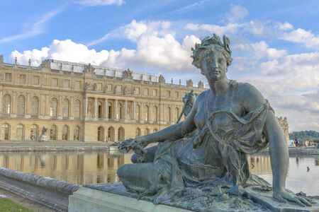 louis the rich heritage: versailles Chateau, Statue and fountain view near Paris, France Editorial