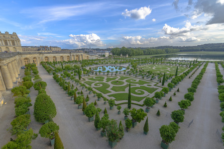 louis the rich heritage: Orangery was designed by Louis Le Vau, it is located south of the Palace Versailles, Paris, France. Versailles was a royal chateau. Editorial